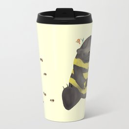 Dark chocolate bear imitating a bee on vanilla background Travel Mug