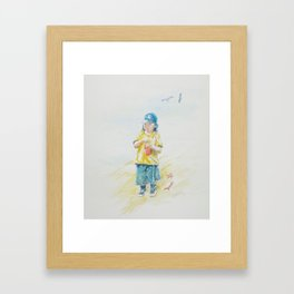 Small boy at the beach. Framed Art Print