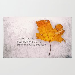 Autumn. Fallen leaf on dirty ice. Rug