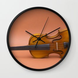 violin on a brown background Wall Clock
