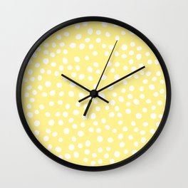 Pastel yellow and white doodle dots Wall Clock