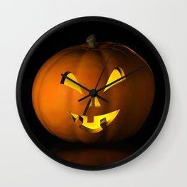 III - Halloween pumpkin on a black reflective surface Wall Clock
