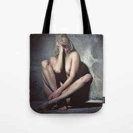 Naked woman in a dark cellar. Image finished with old film grain. Tote Bag
