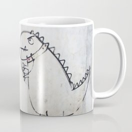 The dinosaur ate his owner Coffee Mug
