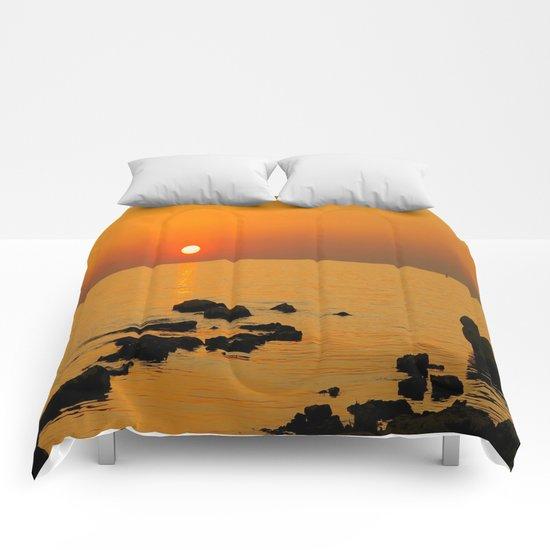 evening beach Comforters