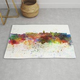 Lansing skyline in watercolor background Rug