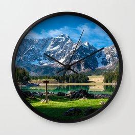 Trekking winter day in the mountains of Friuli-Venezia Giulia, Italy Wall Clock