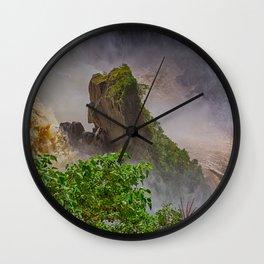 Rock showing in the waterfall Wall Clock