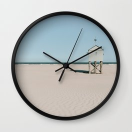 Tiny beach house on the Island Terschelling    Minimalistic travel photography calm ocean sand blue tones Wall Clock