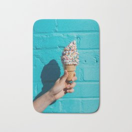 Holding a colorful ice cream Bath Mat