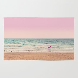 Surfer heads out Rug