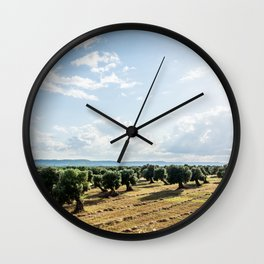 Olive trees in the countryside near the medieval white village of Ostuni Wall Clock