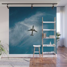 Lonely airplane in the blue sky Wall Mural