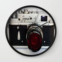 vintage camera Wall Clocks featuring vintage camera Red Lens by 2sweet4words Designs