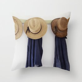 Mens straw hats hanging inside the farmhouse at Yoders Amish Home Throw Pillow