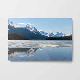 Rocky mountains reflecting in Maligne lake Metal Print