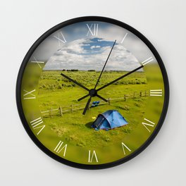 Camping tent on grassland expanse Wall Clock