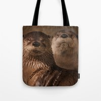 otters Tote Bags featuring River Otters by Joshua Arlington