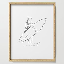 Surfer girl holding a short board and looking at the waves Serving Tray