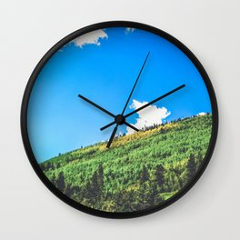 aspens changing color on the mountainside Wall Clock