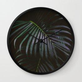 Dark palm leaf botanic photograph - green, violet, blacks Wall Clock