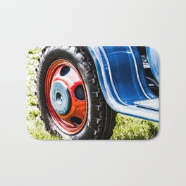 wheel of old tractor Bath Mat