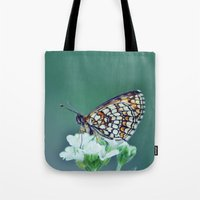 sofa Tote Bags featuring flower sofa by LindaMarieAnson