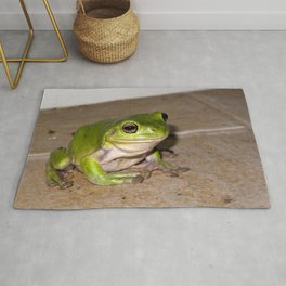A beautiful green tree frog sitting on tiles Rug