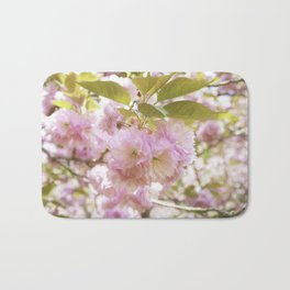 double cherry blossoms with soft hues of pink petals Bath Mat