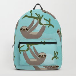 Three-toed sloth on green branch blue background Backpack