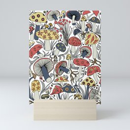 Hand-drawn mushrooms in muted blues, reds and yellows Mini Art Print