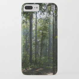 Green forest shrouded the sun. iPhone Case