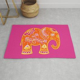 the magic elephant ... orange Rug