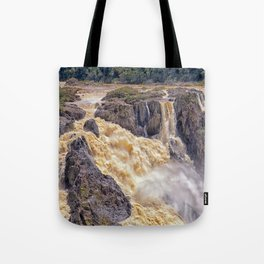Powerful water going over the falls Tote Bag
