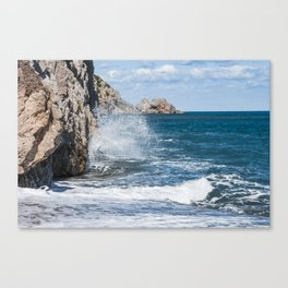 Crashing into rocks Canvas Print