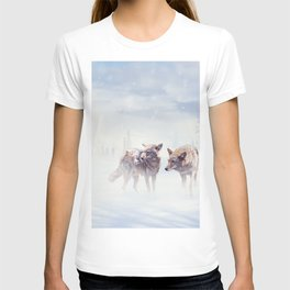 Two coyotes walking  in the winter snow T-shirt