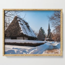 Picturesque street covered in snow at the Village Museum in Bucharest Serving Tray