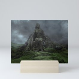 Giant Goddess Statue on a Green Hilly Landscape Mini Art Print