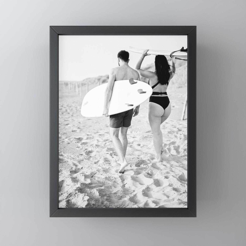 Coastal surf photography print surfer couple in black and white wanderlust wall art framed mini art print by raisazwart