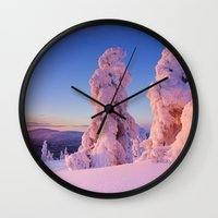 levi Wall Clocks featuring II - Sunset over frozen trees on a mountain, Levi, Finnish Lapland by Sara Winter