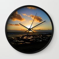 ruben ireland Wall Clocks featuring Lahinch, Ireland by American Artist Bobby B