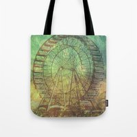 ferris wheel Tote Bags featuring Ferris Wheel by Creative Vibe