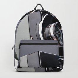 Retro hobbies movie camera in hands Backpack