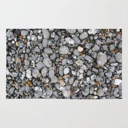pebbles on the beach Rug