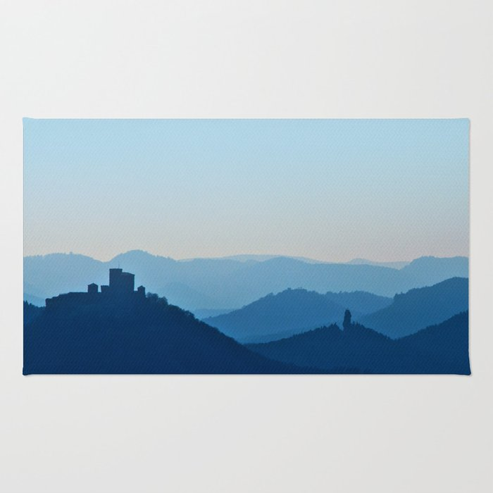 Castle in blue misty mountains Rug