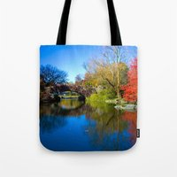 central park Tote Bags featuring Central Park by Davide Carnevale