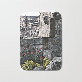 Sassi di Matera: stones and flowers Bath Mat