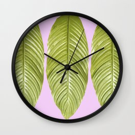 Three large green leaves on a pink background - vivid colors Wall Clock