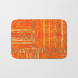 Tribal Ethnic pattern gold on bright orange Bath Mat