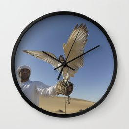 Falconer With Hooded Falcon In The Desert Wall Clock